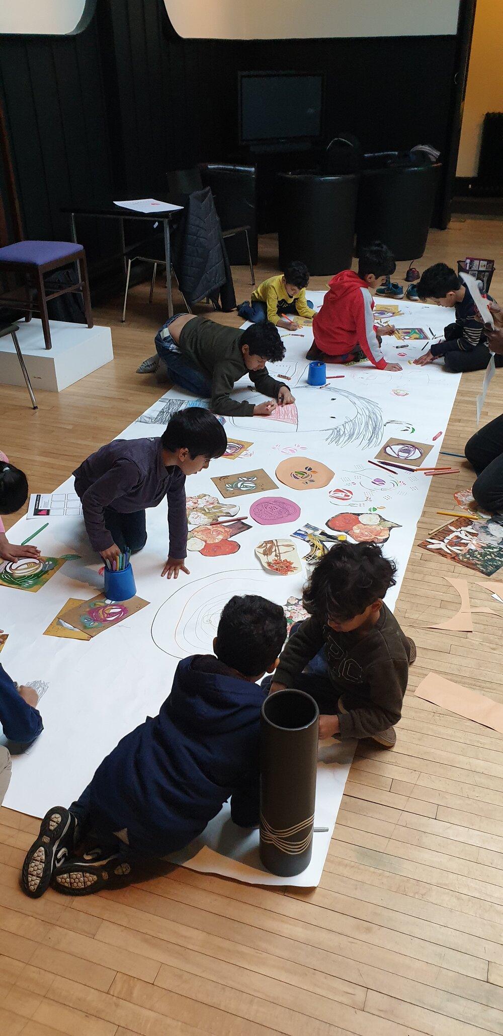 photograph of children taking part in a mackintosh art workshop