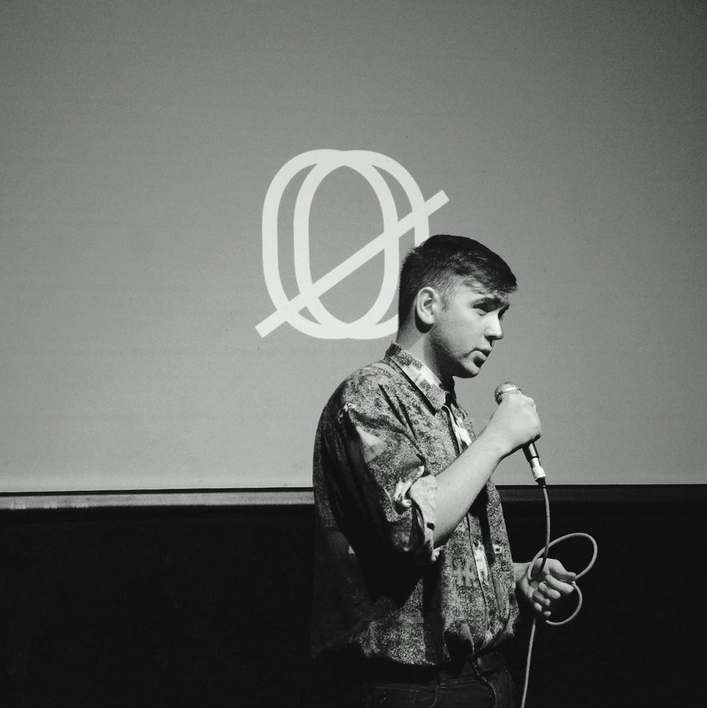 a black and white image of Cairan McLaggan with microphone