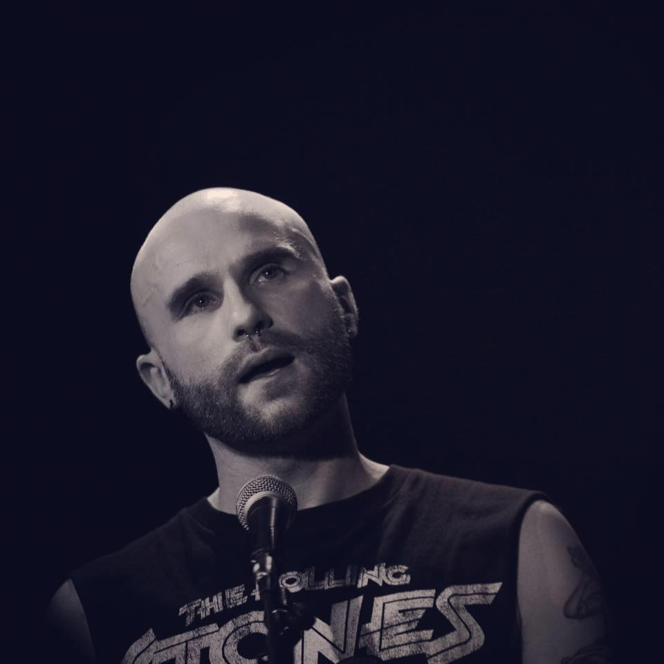 a profile picture of Daniel in black and white performing.