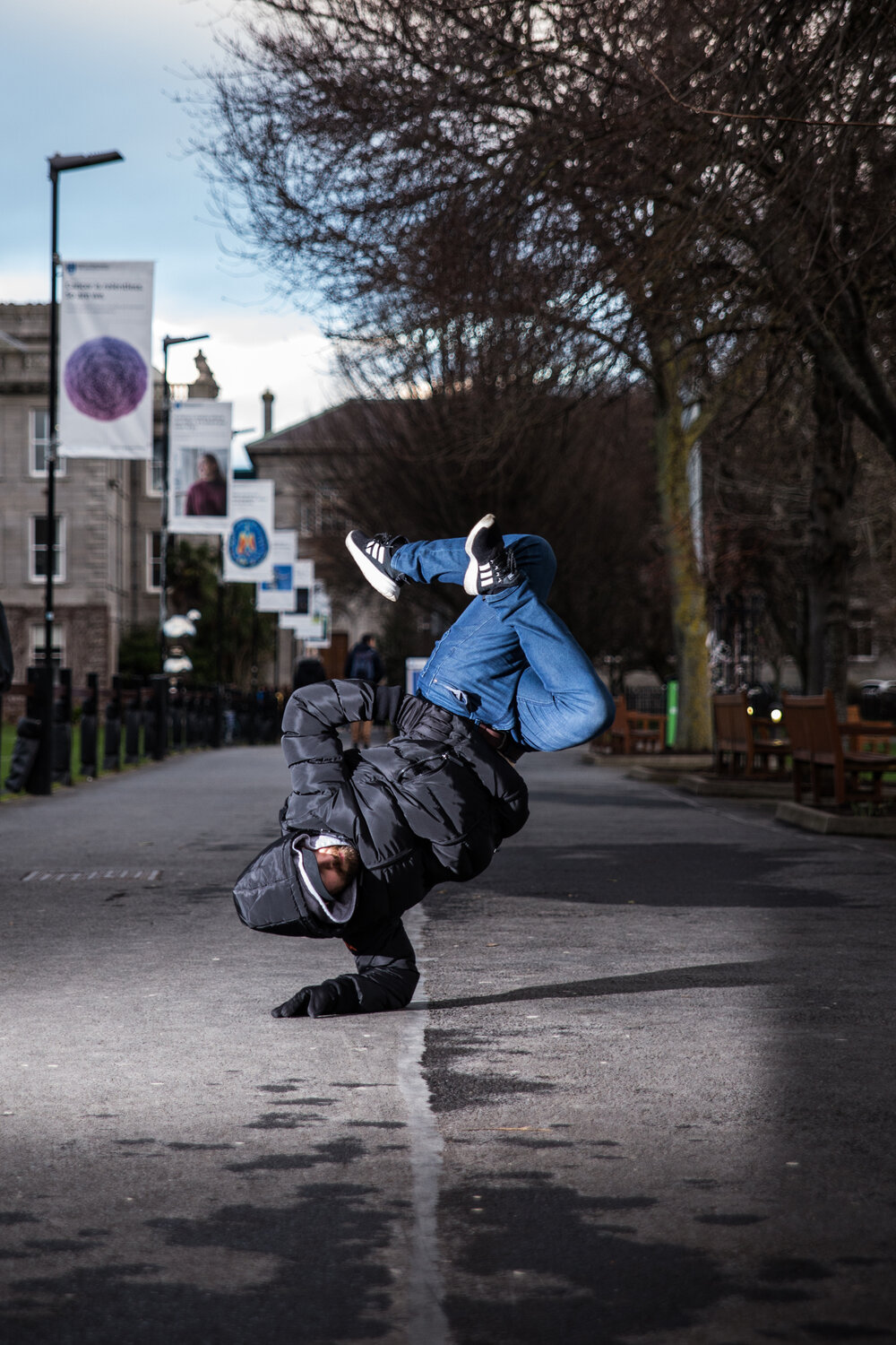 photograph of ChazB breakdancing in the middle of a street