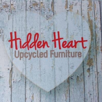 hidden heart upcycled furniture written in red and brown tex with an upcycled wood affect background with heart shape.