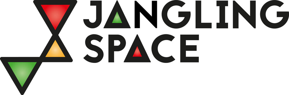 jangling space logo with black text on white background and colourful triangles at left side in red, yellow and green.