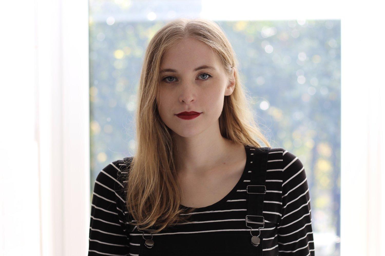 a headshot of Jen Athan.