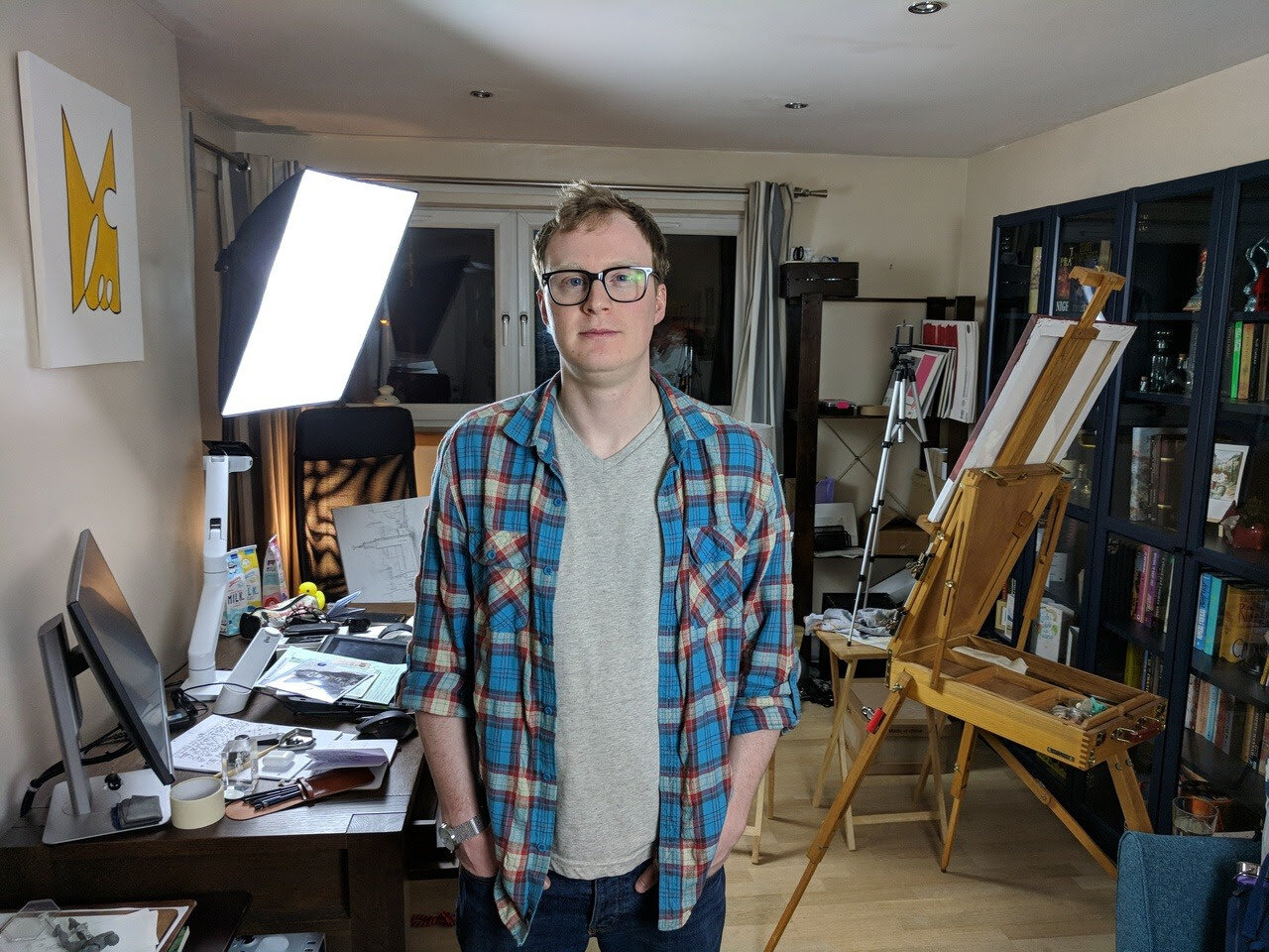 Lee McGuire standing in his studio looking at camera.