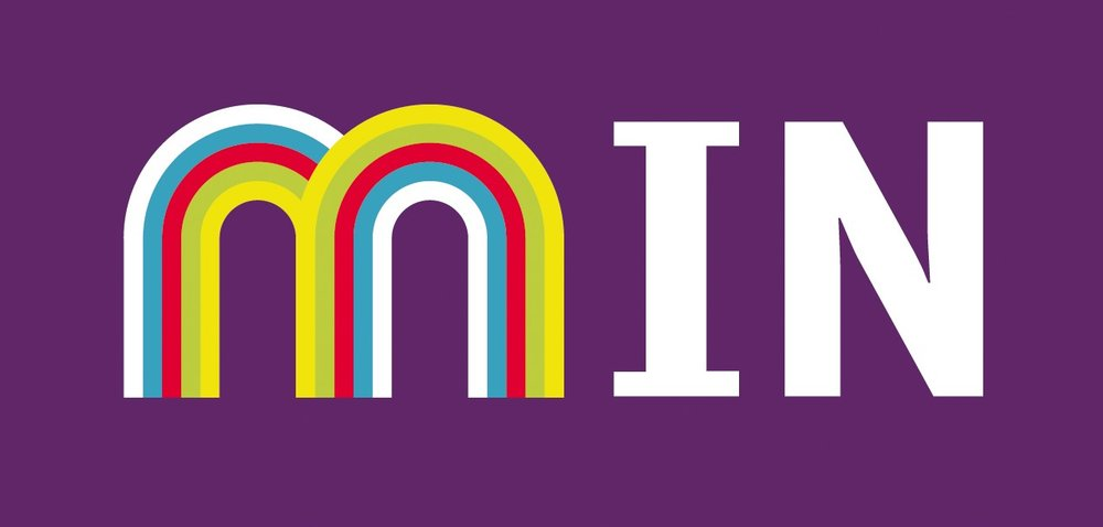 Maryhill Integration Network logo on purple background with multicoloured M and white I and N letters.
