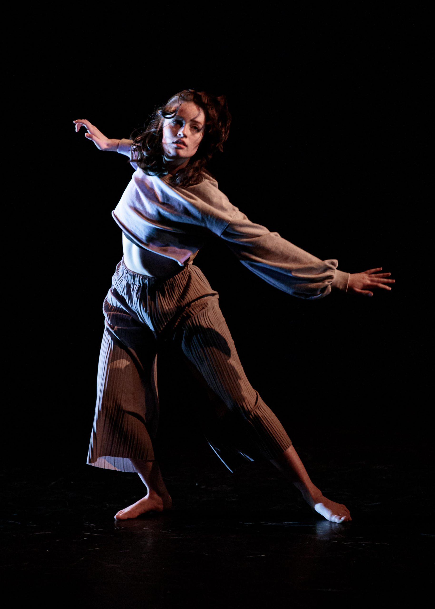 image of Amber performing a dance against a black background.