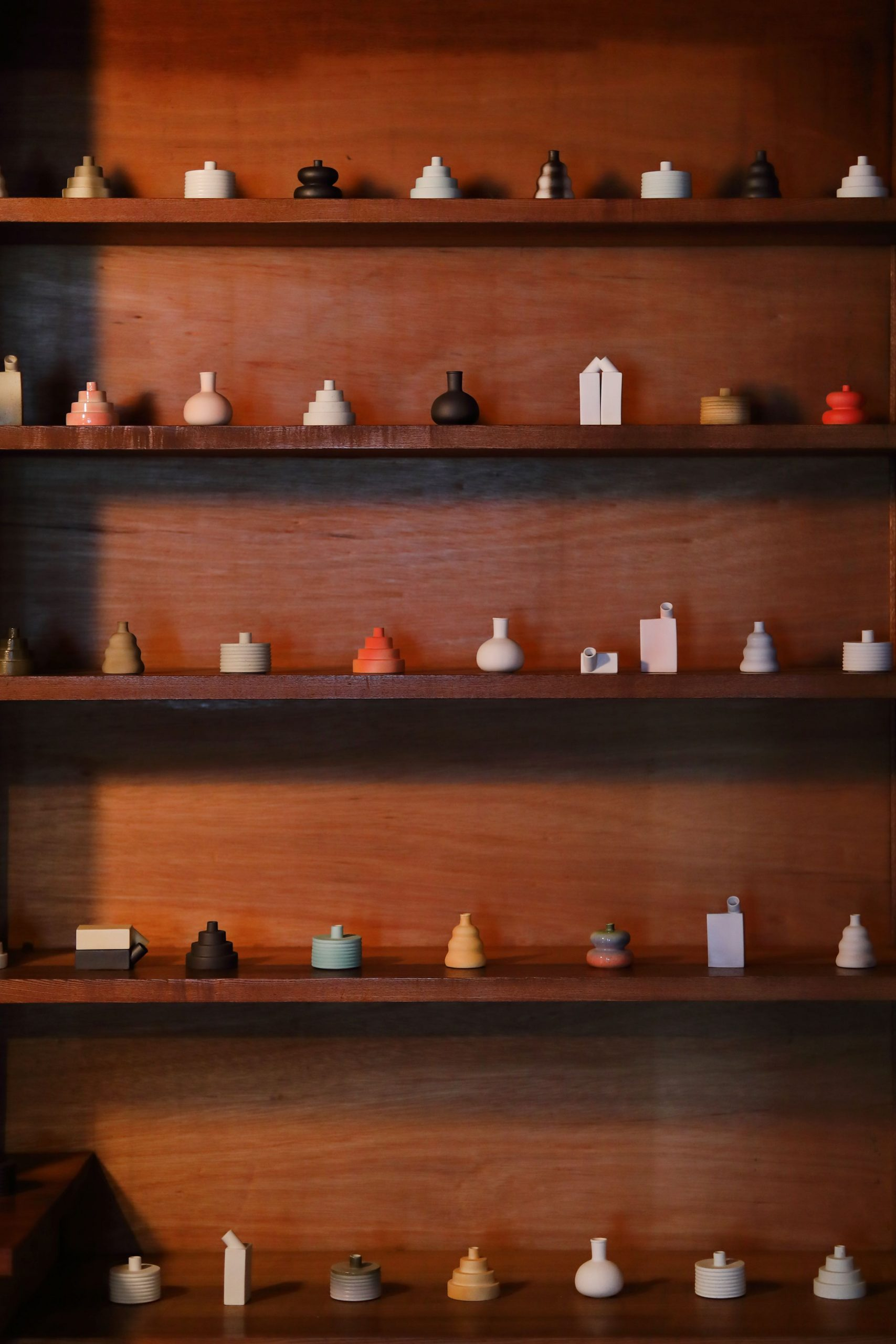 a shelf stacked with small ceramic objects.