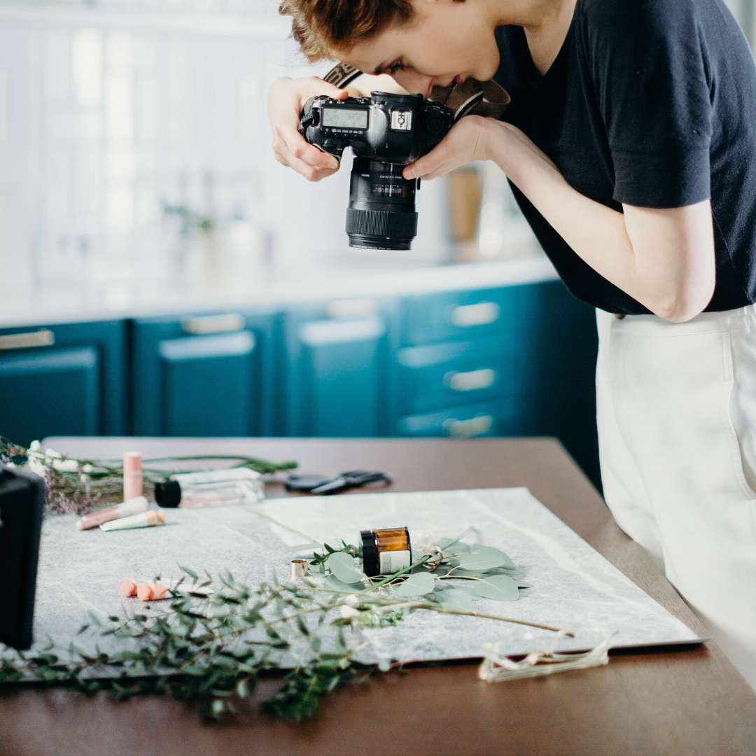 image of a maker supported by the scottish business collective photographing their work.