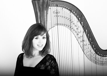 profile image of Sophie in black and white in front of her Harp.