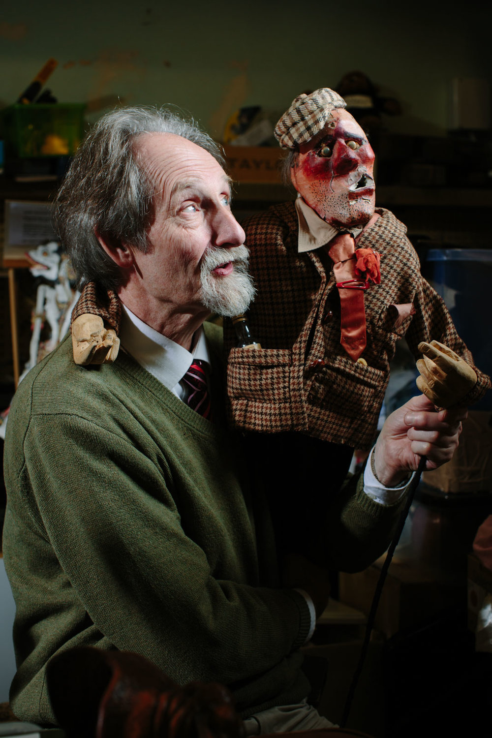 Malcolm from Scottish Mask and Puppet Centre holding up one of the puppets.
