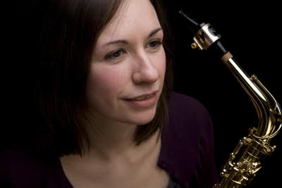 profile image of karen dufour next to saxophone