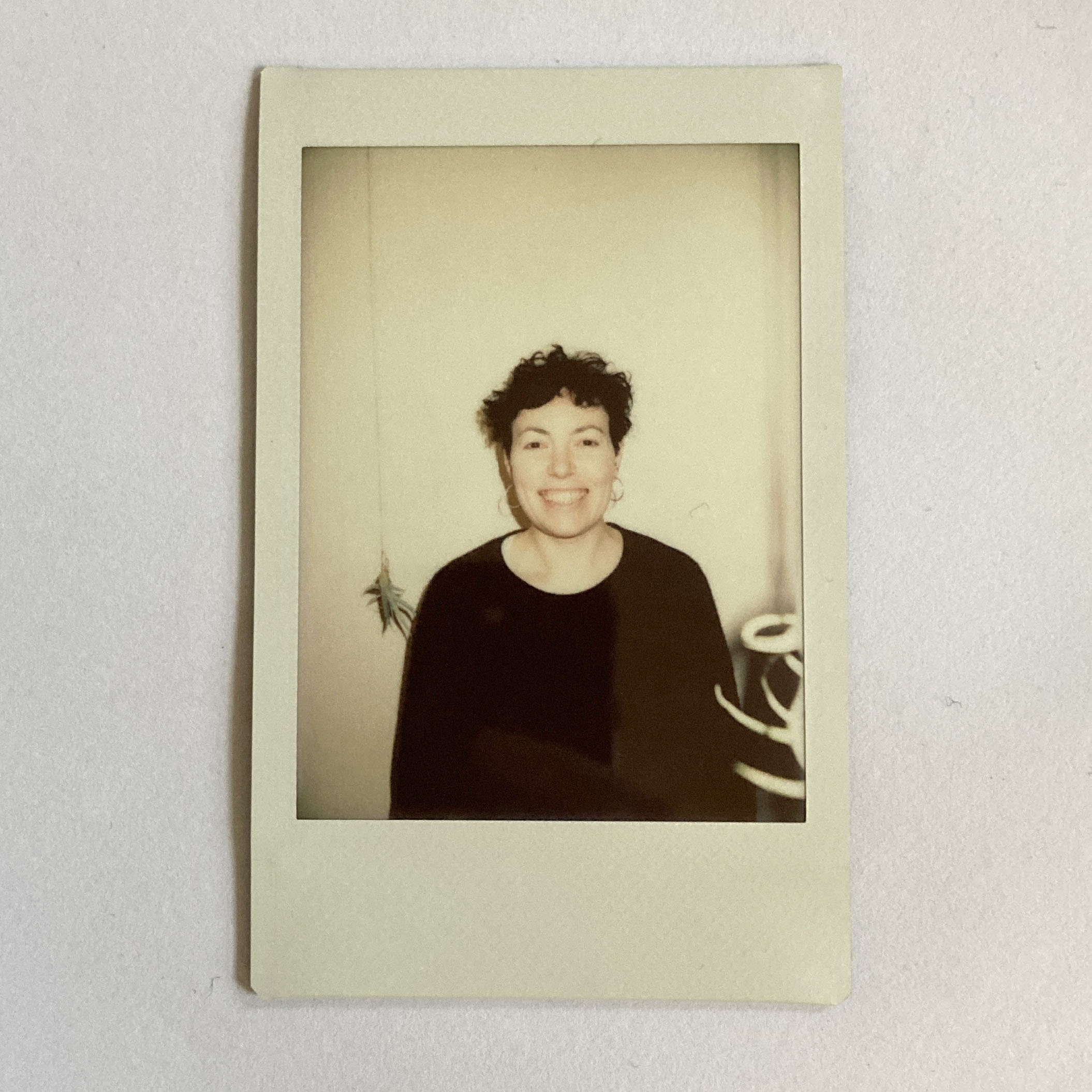 profile image of Marie- Claire Lacey on a polaroid.