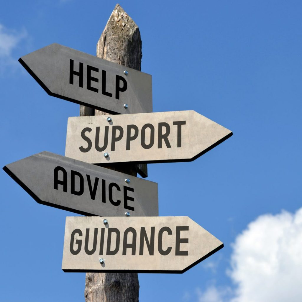a signpostin front of a blue sky background with signs pointing in different directions. They say help, support, advice, guidance.