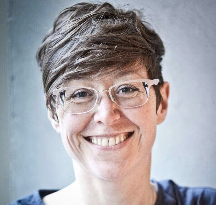 profile image of Abigail. A woman in her 40's with short brown hair and glasses.